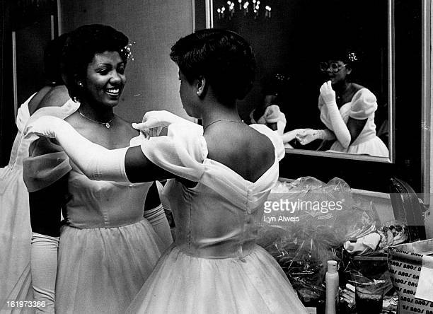 Wylene Lawrence, right, adjusts Juanita Kay Hardy's shoulder straps prior to the dinner of Sigma Gamma Rho Sorority Inc.;