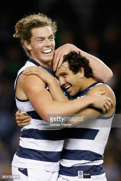 Wylie Buzza and Nakia Cockatoo of the Cats celebrate a goal during the round 19 AFL match between the Carlton Blues and the Geelong Cats at Etihad...