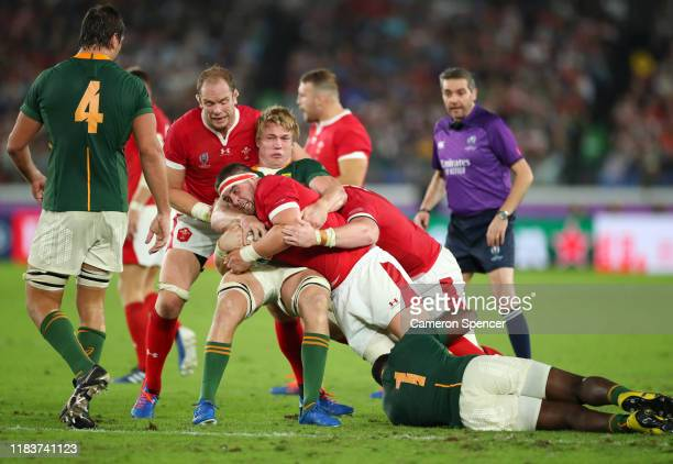 Wyn Jones of Wales is tackled by PieterSteph Du Toit of South Africa during the Rugby World Cup 2019 SemiFinal match between Wales and South Africa...