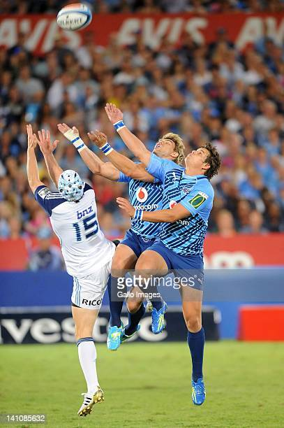Wynand Olivier Francois Venter of the Bulls and Lachie Munro of the Blues go for the ball during the 2012 Super Rugby match between Vodacom Bulls and...