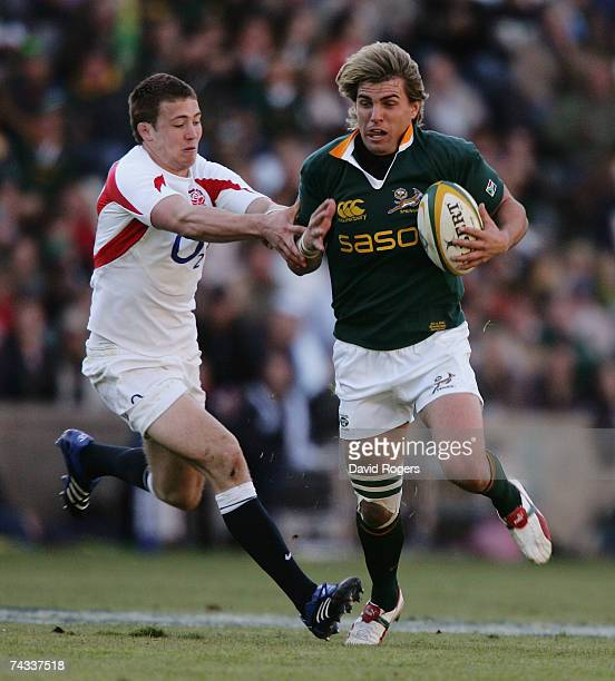 Wynand Olivier moves away from Mike Brown during the rugby union international match between South Africa and England at Vodacom Park on May 26 2007...