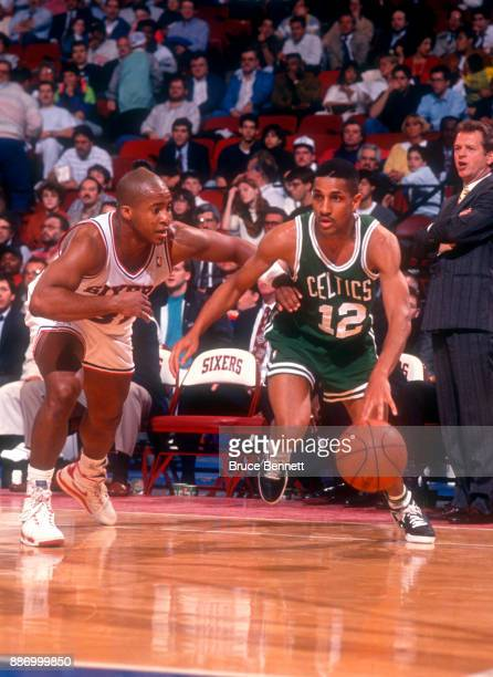 J Wynder of the Boston Celtics drives against Brian Oliver of the Philadelphia 76ers during an NBA game on April 18 1991 at the Spectrum in...