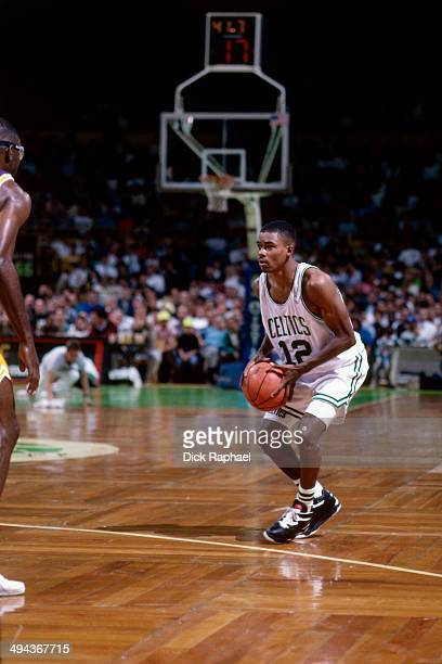 J Wynder of the Boston Celtics looks to make a play with the ball against the Los Angeles Lakers during a game played in 1992 at the Boston Garden in...
