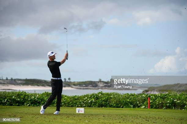 Wyndham Clark plays his shot from the 13th tee during the first round of the Webcom Tour's The Bahamas Great Exuma Classic at Sandals Emerald Bay...