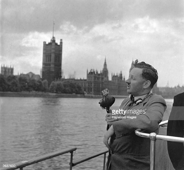 Wynford Vaughan Thomas commentating for radio opposite The Houses of Parliament Original Publication Picture Post 4853 Radio's TopLine Reporters pub...