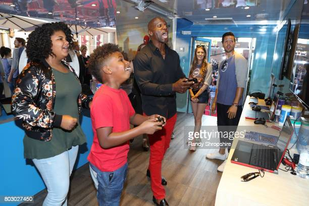 """Wynfrey Crews, Isaiah Crews and actor Terry Crews at the Dell VR Experience at the """"Spider-Man: Homecoming"""" World Premiere at TCL Chinese Theatre on..."""