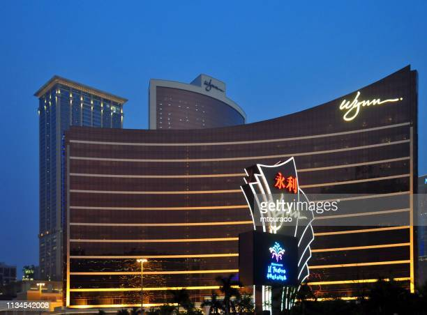 wynn macau  hotel and casino and sign at dusk, macau, china - wynn las vegas stock pictures, royalty-free photos & images