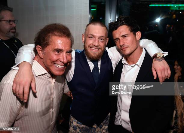Wynn Resorts Chairman and CEO Steve Wynn Conor McGregor and actor Orlando Bloom appear at Andrea's restaurant in Encore at Wynn Las Vegas prior to...