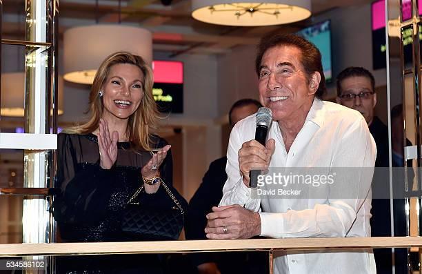 Wynn Resorts Chairman and CEO Steve Wynn speaks as his wife Andrea Wynn applauds during the grand opening of the Wynn Las Vegas Poker Room at Wynn...