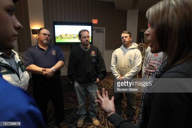 Wynn Resorts employee Jeanie Jones right talks to attendees at an informal meet and greet held at the Patriot Place Renaissance Hotel to answer...
