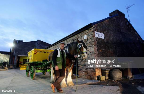 Wynne Hull stands next to Hope the Shire horse at Salford Skip Hire Salford The animal will lead a go slow fuel protest into Manchester City Centre...
