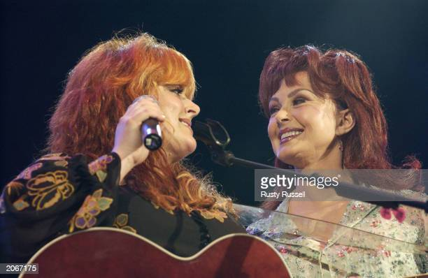 Wynonna and Naomi Judd perform at the 32nd Annual Fan Fair country music festival on June 8 2003 in Nashville Tennessee The fourday festival staged...