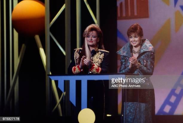 Wynonna Judd Naomi Judd The Judds presenting on the 17th Annual American Music Awards Shrine Auditorium January 22 1990