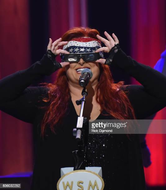 Wynonna Judd tries on her ECLIPSE glasses during Grand Ole Opry Total Eclipse 2017 Special Sunday Night Show at Grand Ole Opry House on August 20...
