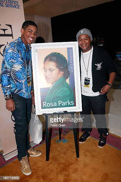 Wynton Harvey and Kyle Massey preview the Rosa Parks Forever Stamp at the USPS Civil Rights Stamp Gallery at the NAACP Image Awards at The Shrine...