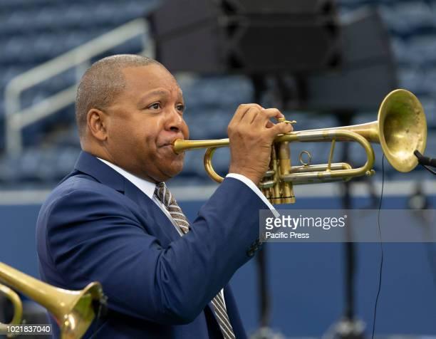 Wynton Marsalis plays trumpet during New Louis Armstrong stadium dedication at USTA Billie Jean King National Tennis Center