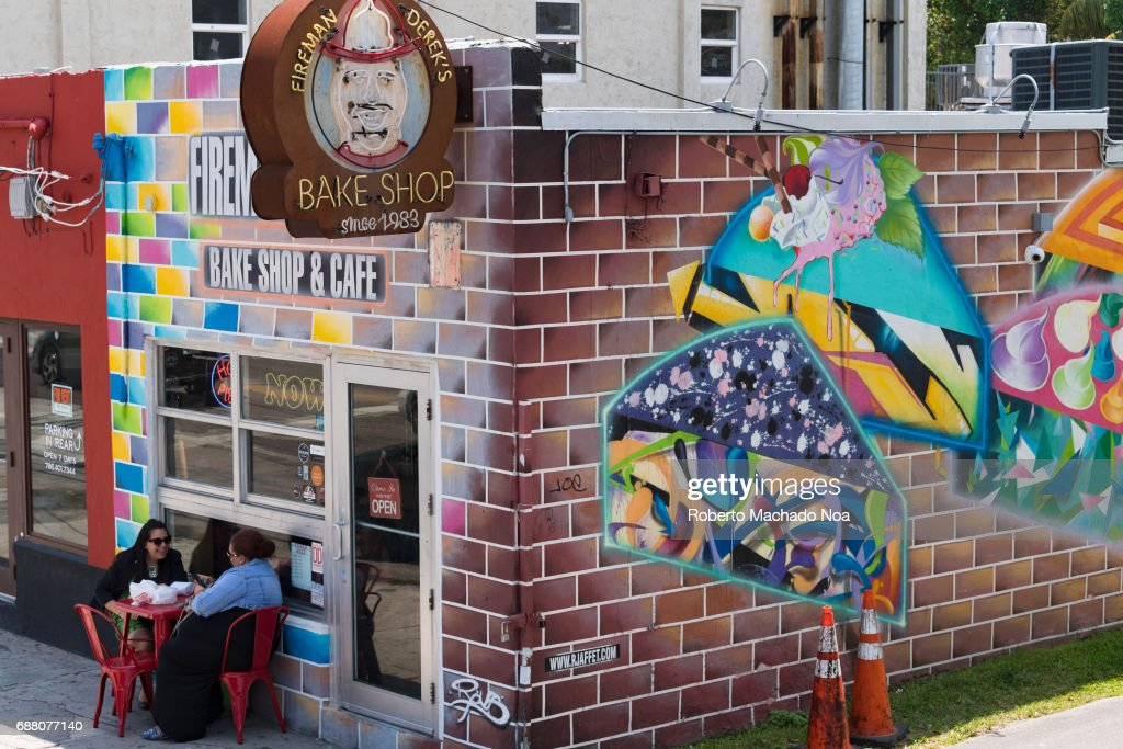 Wynwood walls or midtown Miami: women having a snack in... Pictures ...