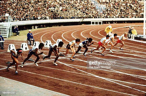 Wyomia Tyus of USA and athletes compete in the Women's 100m final during Tokyo Olympic at the National Stadium on October 16 1964 in Tokyo Japan