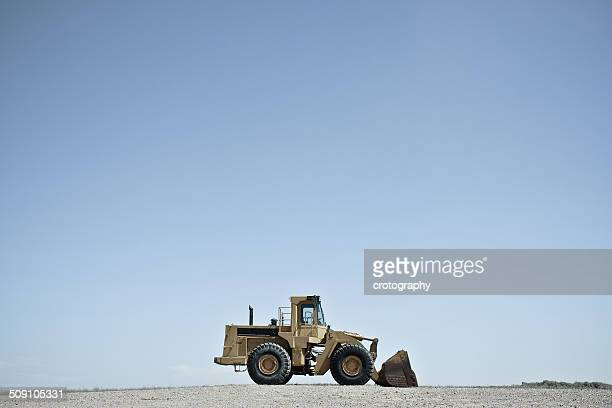 USA, Wyoming, Bulldozer against blue sky