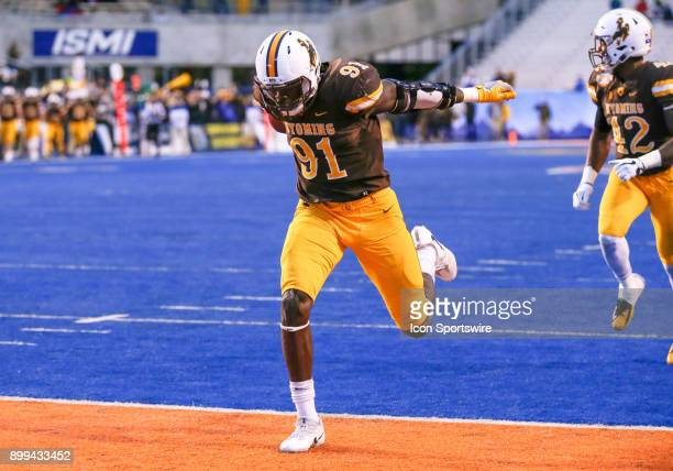 Wyoming Cowboys defensive end Carl Granderson lunges for the goal line as he returns the ball for a 58 yard for a touchdown during Famous Idaho...