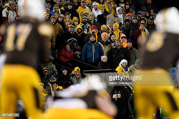 Wyoming Cowboys fans bundle up as the watch Josh Allen of the Wyoming Cowboys take the snap against the San Diego State Aztecs during the first...