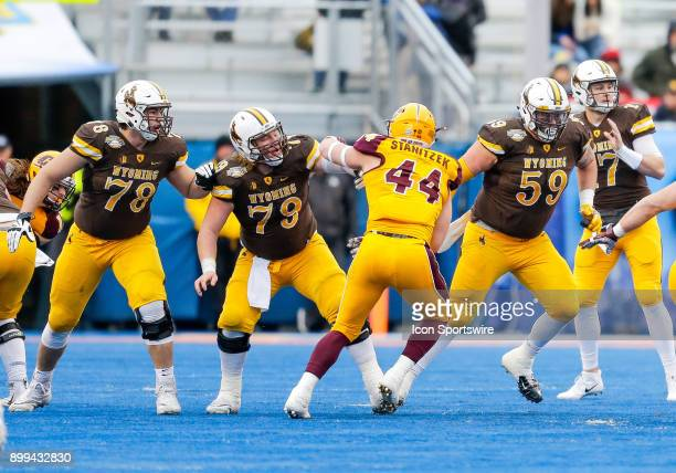 Wyoming Cowboys offensive tackle Alonzo Velazquez Wyoming Cowboys offensive lineman Logan Harris and Wyoming Cowboys offensive tackle Ryan Cummings...