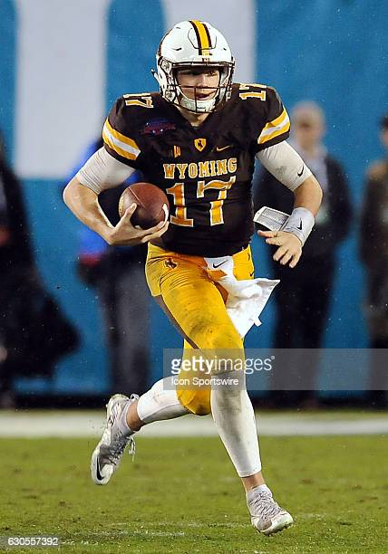 Wyoming Cowboys quarterback Josh Allen scrambles for a gain during the fourth quarter against the BYU Cougars during the Poinsettia Bowl on December...