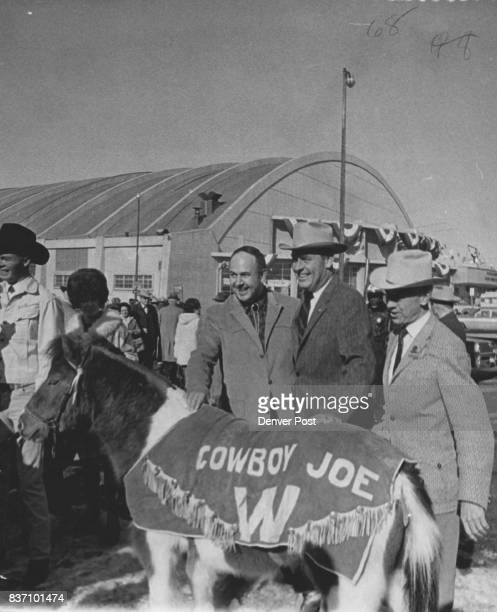 Wyoming Gov Stan Hathaway Left Greeted On Arrival For Stock Show Colorado Gov John Love center and Willard Simms stock show general manager welcomed...