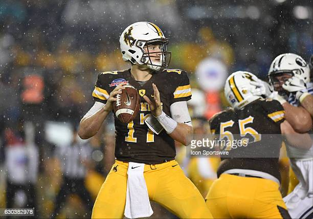 Wyoming Josh Allen drops back to pass during the San Diego Credit Union Poinsettia Bowl game between the BYU Cougars and the Wyoming Cowboys on...