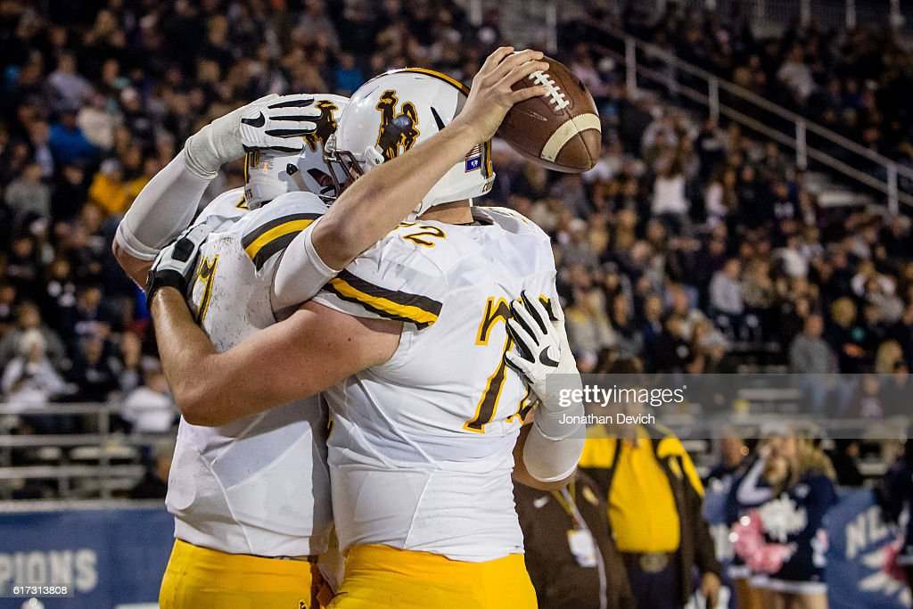 Wyoming players celebrate after making a touchdown against Nevada at Mackay Stadium on October 22, 2016 in Reno, Nevada.