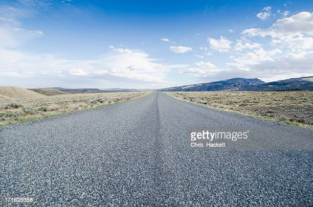 USA, Wyoming, Road going through desolate landscape