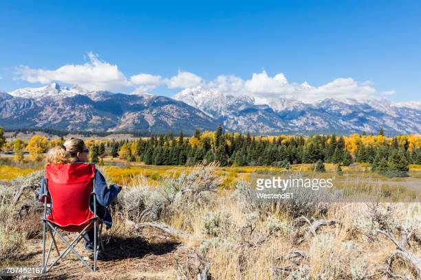 USA, Wyoming, Rocky Mountains, Grand Teton National Park, Snake River, Cathedral Group, woman enjoying view on Teton Range