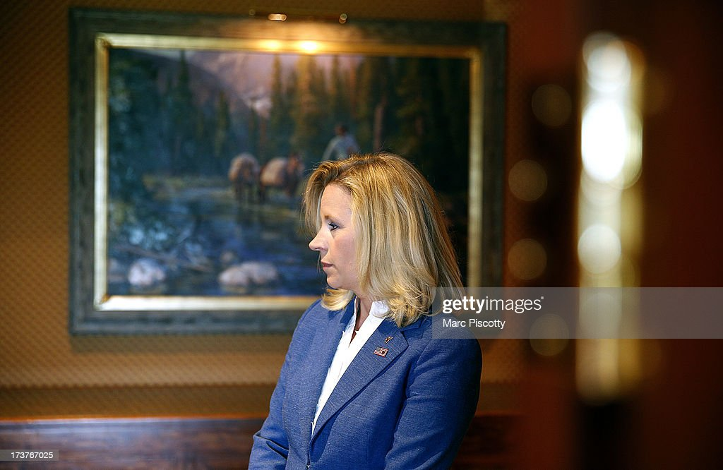 Wyoming Senate candidate Liz Cheney waits in the hallway for a news conference to begin at the Little America Hotel and Resort in Cheyenne, Wyoming on July 17, 2013. Cheney, the daughter of former Vice President Dick Cheney, will run against longtime incumbent Sen. Mike Enzi (R-WY). Cheney launched her campaign yesterday following Enzi's announcement that he will run for a fourth term.