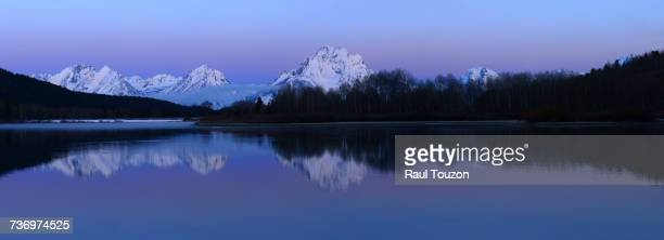 Mount Moran and aspens reflected on Oxbow Bend in Grand Teton National Park.