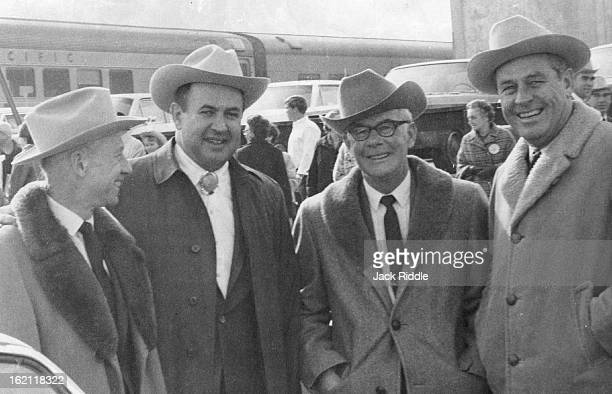 JAN 9 1962 JAN 11 1968 Wyoming visitors welcomed to the National Western by Willard Simms left show manager *****