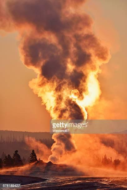 USA, Wyoming, Yellowstone National Park, Upper Geyser Basin, Old Faithful Geyser steaming at sunrise