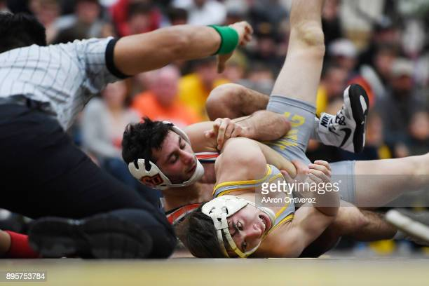 Wyoming's Drake Foster looks for an escape against Oklahoma State's Nick Piccininni during Piccininni's 141 win on December 19 2017 The No 19 Wyoming...