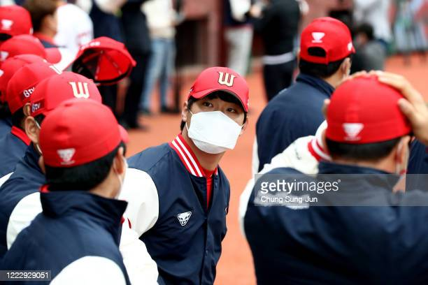 SK Wyverns players wear masks before the Korean Baseball Organization League opening game between SK Wyverns and Hanwha Eagles at the empty SK Happy...