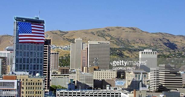 A 180' x 127' American flag hangs on top of the Salt Lake Olympic Committee 24 storey building in downtown Salt Lake City Utah 19 September 2001 The...