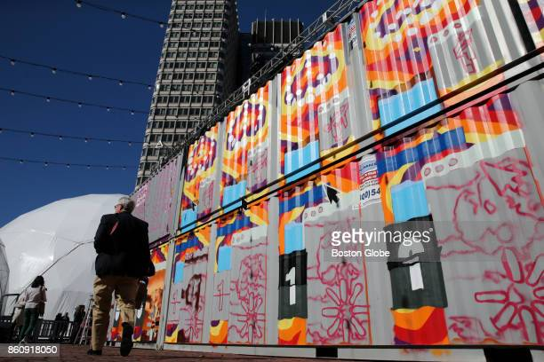 A 60' x 18' animated mural known as GIFITI by featured artist INSA is being painted on a container during HUBweek at City Hall Plaza in Boston on Oct...