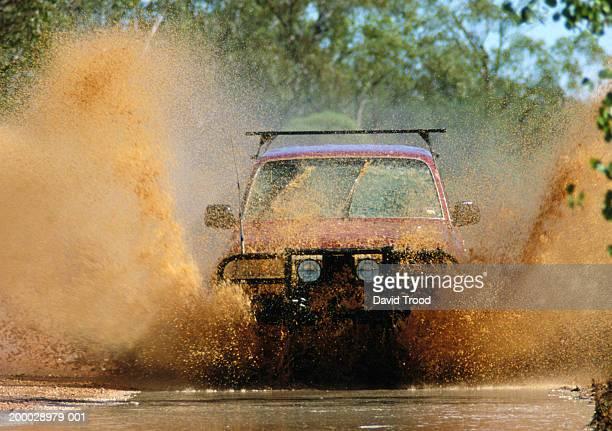 4 x 4 driving through mud