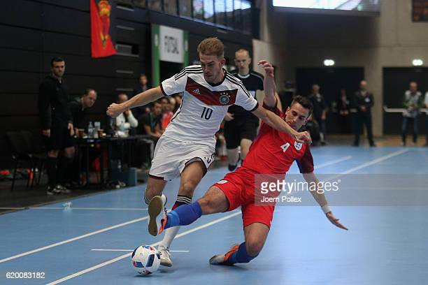 x of Germany and x of England battle for the ball during the Futsal International Friendly match between Germany and England at Inselparkhalle on...