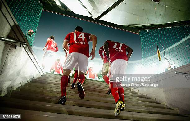 Xabi Alonso and David Alaba of Bayern enter the pitch after half time during the Bundesliga match between Bayern Muenchen and Bayer 04 Leverkusen at...