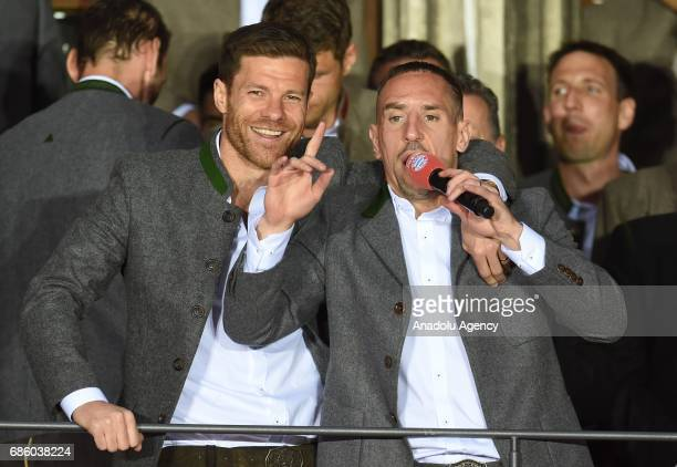 Xabi Alonso and Franck Ribery of Bayern Munich celebrate winning the German soccer championship on a balcony of the town hall in Munich Germany on...