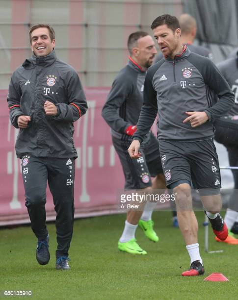 Xabi Alonso and Philipp Lahm of FC Bayern Muenchen warm up during a training session at the club's Saebener Strasse training ground on March 9 2017...
