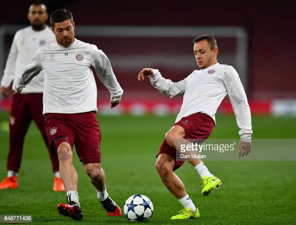 Xabi Alonso and Rafinha of Bayern Muenchen compete for the ball during the FC Bayern Muenchen training session at the Emirates Stadium on March 6...