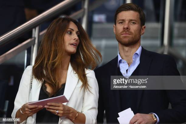 Xabi Alonso attends with his wife Nagore Aramburu the UEFA Champions League group B match between Paris SaintGermain and Bayern Muenchen at Parc des...