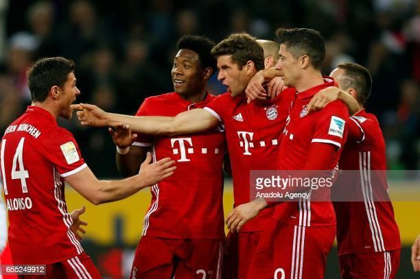 Xabi Alonso David Alaba Arjen Robben Thomas Mueller and Robert Lewandowski of Bayern Munich celebrate scoring a goal during the Bundesliga Match...