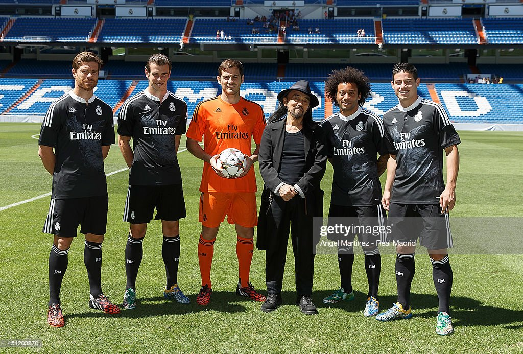 Xabi Alonso, Gareth Bale, Iker Casillas, Marcelo Vieira and James Rodriguez of Real Madrid pose with designer Yohji Yamamoto during the adidas 3rd kit launch at Estadio Santiago Bernabeu on August 26, 2014 in Madrid, Spain.