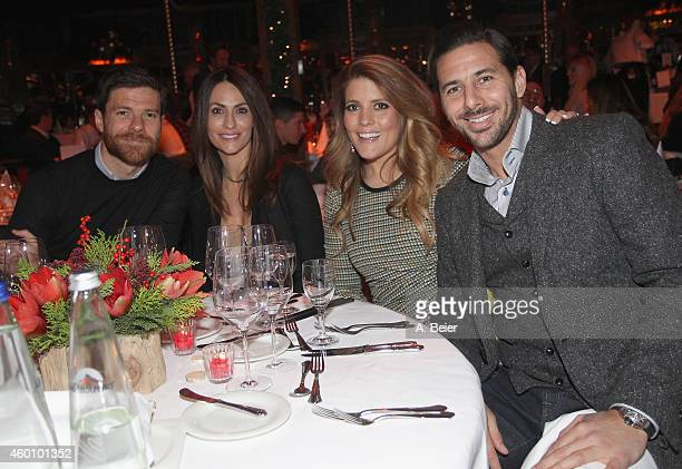 Xabi Alonso his wife Nagore Aramburu and Claudio Pizarro and his wife Karla Salcedo attend the FC Bayern Muenchen Christmas Party at Schuhbeck's...